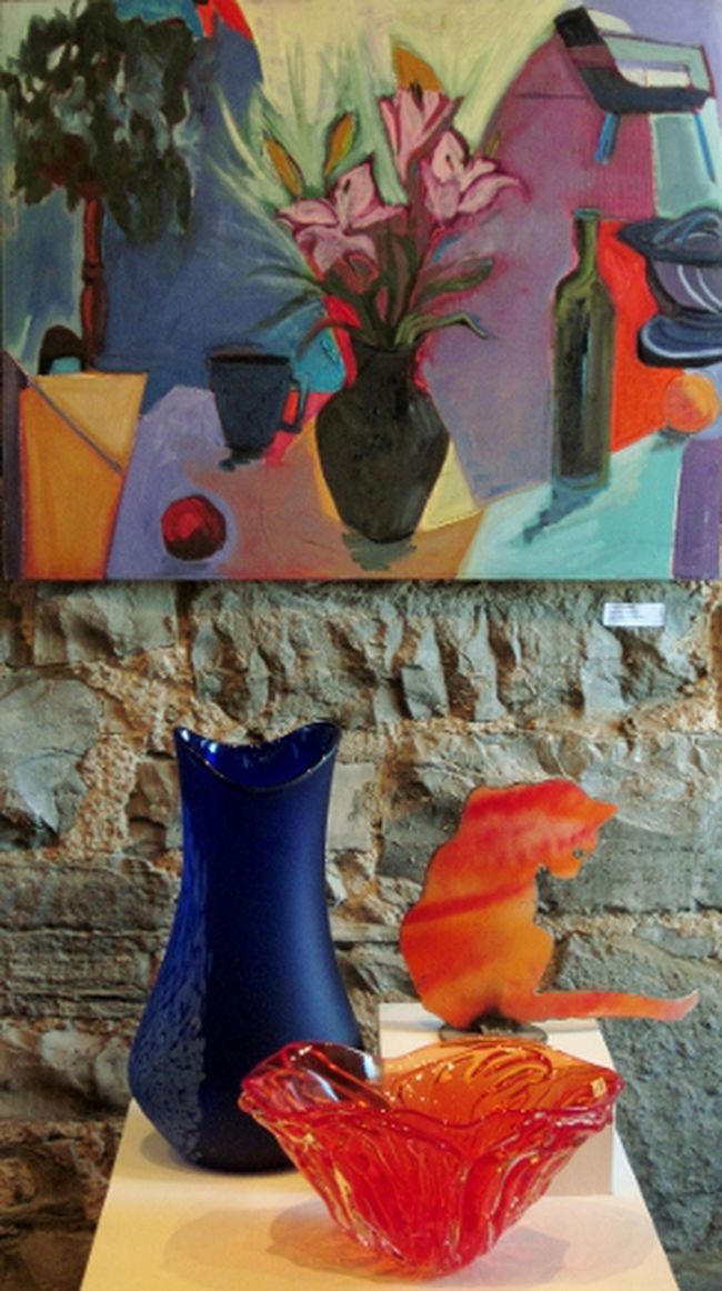The painting Lilies in Black Pot is on exhibition as part of the