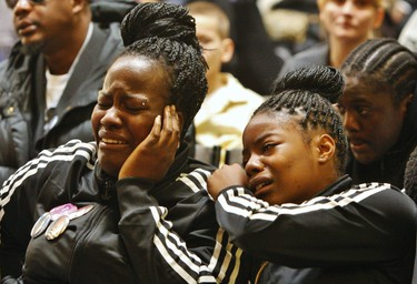 Tyson Bailey's sisters sobs filled Toronto Central Seventh-day Adventist Church during the slain teen's funeral Thursday Jan. 31, 2013. (Chris Doucette/Toronto Sun)