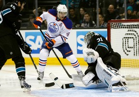 Taylor Hall is stopped by Antii Niemi in first-period action between the Oilers and Sharks Thursday in San Jose. Hall tied the game in the third period, sending it into overtime. (Reuters)