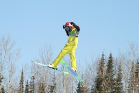 Skier Roy Compton prepares for landing off the table top kicker at Mount Evergreen's Terrain Park, Jan. 27.