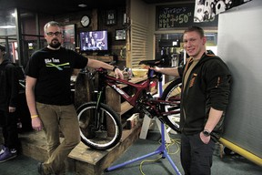 Devon Bicycle Association (DBA) president Kevin Haugjord (left) with DBA member and area resident Mackenzie Haut with one of two bicycles Haut donated to the club. The bikes are to be subsequently donated to two deserving local riders, yet to be determined.
