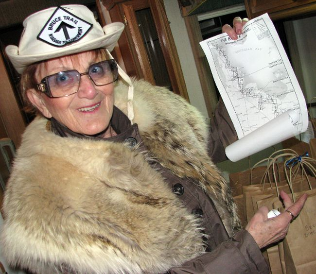 Betty Dee Black of Sarnia, Ont. is off on another epic walk in May, this time to raise money for the St. Joseph's Hospice. During First Friday on Feb. 1, 2013, she was downtown preparing volunteer walkers who will accompany her on the Bruce Trail by handing out maps and pledge sheets.  Black said she plans to raise at least $1 million. (CATHY DOBSON, The Observer)