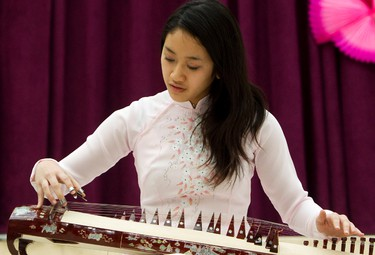Huong Hoang plays the zither as she performs during Vietnamese New Year celebrations at City Hall, in Edmonton, Alta. on Sunday Feb. 3, 2013. David Bloom/Edmonton Sun/ QMI Agency