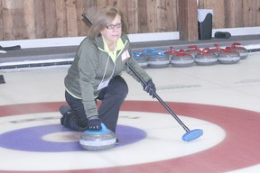 Marianne Simpson of Team Simpson throws a rock during the Curling for Cancer event held on Feb. 2 at the Chatham Granite Club. The 20th annual event attracted 40 curlers and raised $9,250 for the Canadian Cancer Society. Each of the 10 rinks played two six-end games.