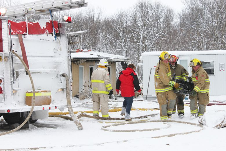 Firefighters retrieve computer equipment from the offices after a devastating fire at MDL Doors near Brussels & MDL Doors employees learn plant will not reopen   Seaforth Huron ...