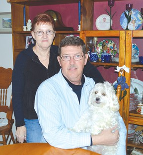 This is the modern face of Alzheimer's disease say Shirley and Tim Masson. Shirley was diagnosed with Alzheimer's disease in August of 2012. They are accompanied in the photo by Becky, the shih tzu-poodle mix canine. Photo by KEVIN McSHEFFREY/THE STANDARD/QMI AGENCY