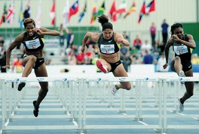 Canadian hurdler Priscilla Lopes-Schleip, centre, was among the elite athletes competing at last year's Donovan Bailey Invitational at Foote Field. The annual meet goes back to its original Edmonton International title this year.
