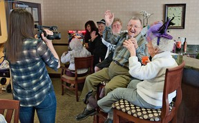 BRIAN THOMPSON, The Expositor  Videographer Stephanie Gash tapes Seasons Bell Lane residents, including Don Howarth and Norma Dick, having a good time on Wednesday for a video.