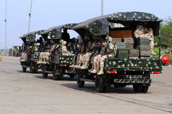 Nigerian soldiers sit in military trucks at the airport in Nigeria's northern state of Kaduna before leaving for Mali on Jan. 17. When French and Malian forces eventually put down the rebellion, writes columnist Geoffrey Johnston, Ottawa and Washington should redouble their efforts to stabilize the region through closer political, economic and security co-operation.