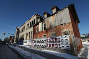 A crumbling building at 287 Cumberland Street in Ottawa, Ont. Tuesday Feb 5, 2013. The city of Ottawa has been ordered to repair the unsafe heritage building.  Tony Caldwell/Ottawa Sun/QMI Agency