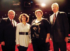 MP Guy Lauzon and staff from St. Lawrence College stand on stage at Aultsville Theatre after Lauzon announced the theatre will receive funding from the Community Infrastructure Improvement Fund of up to $64,350 to help upgrade the lighting and sound systems. Staff photo/ERIKA GLASBERG