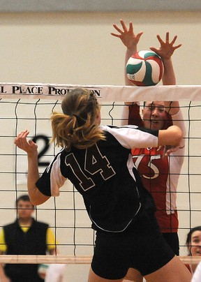 Barb Cranston	of the Wolves blocks the kill attempt from Griffin  Kimberly Bolin.The (national) No. 15 ranked Grande Prairie Regional College Wolves beat the No. 7 ranked Grant MacEwan Griffins 3-1 in ACAC women's volleyball at GPRC gym in Grande Prairie, Alberta, Friday, Feb. 8, 2013.TERRY FARRELL/DAILY HERALD-TRIBUNE/QMI AGENCY