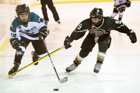 MONTE SONNENBERG Simcoe Reformer Steve Fennel, left,  of the Simcoe Warriors was dangerous all game against Pelham on Saturday. However, skate as they might, the atom AE's couldn't solve the Panthers' defence en route to a 2-0 loss at the Simcoe Recreation Centre.