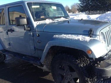 Jeremy Beaumier had scary moment while driving on the 417 on Saturday, Feb. 9, 2013. Teenagers where perched above the highway on the Pinecrest/Greenbank overpass throwing packed snow and ice onto oncoming traffic. One of them took aim at Beaumier's vehicle and hit it dead on. Photo courtesy of Jeremy Beaumier