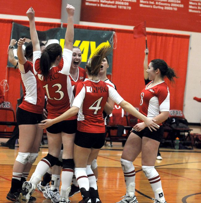 The Wolves celebrate after the upset win. The (national) No. 15 ranked Grande Prairie Regional College Wolves beat the No. 7 ranked Grant MacEwan Griffins 3-1 in ACAC women's volleyball at GPRC gym Friday. (Terry Farrell/Daily Herald-Tribune)