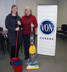 VON Middlesex-Elgin client services co-ordinators Pam Buys, left, and Ellen Cannon with a few cleaning supplies at VON's South Edgeware Rd. office. The VON is offering new home care services including house cleaning for St. Thomas seniors with areas of the county to follow later. (Nick Lypaczewski Times-Journal)
