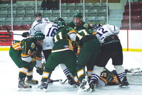 Broncos' Logan Ginn and Chris Hrabec try to find the loose puck while the Warriors' goalie lunges out to make the save. Beaver Brae lost 3-1. GRACE PROTOPAPAS/Daily Miner and News