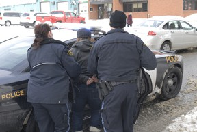 The OPP put a suspect in the back of the cruiser after executing a search warrant at residence on Government Road East.