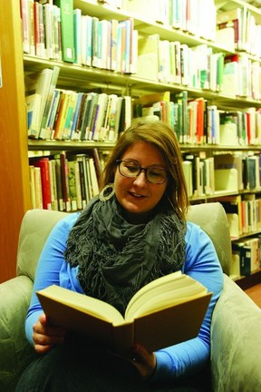 Lyndsey Darling relaxes as she reads a book at the Central Branch of the Kingston Frontenac Public Library. Darling is the driving force behind a 50-book challenge encouraging everyone to read 50 books over the next year.      Rob Mooy - Kingston This Week