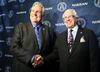 The Double Blue's big boss Chris Rudge (right) congratulates his general manager Jim Barker for a job well done and a new contract which runs until the end of the 2015 CFL season. (DAVE ABEL/TORONTO SUN)