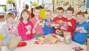 Pictured holding up their Valentine's Day treats (left to right) are Meghan McNabb, Brooklyn Banks, Liam Doherty, Bryce MacLean, Emmett Jackson, Jacob Drummond and Parker Kaake.