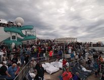 Carnival Triumph passengers waiting for the helicopter to make cargo deliveries. (Faraz Ismail photo)