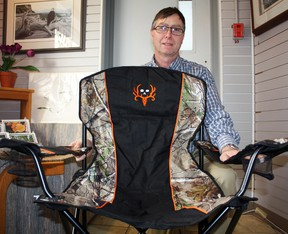 """The Heart of Gold Gobblers, the local chapter of the National Wild Turkey Federation (NWTF) will be hosting its 1st Annual Hunting Heritage Banquet at the McIntyre Ballroom on Feb. 23. Chapter president Jim Nawroski, pictured, said he expects it to be """"the event of the year,"""" and said that over $20,000 worth of valuable prizes will be up for auction and raffle, including this handy foldable outdoors chair (pictured)."""