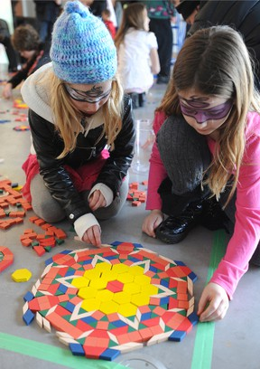 Spenser Stewart, 12, and Maggie Mullins, 9, both of Sarnia, participate in an art project at the Judith & Norman Alix Art Gallery. The gallery is hosting Art & Ideas: Escher for Beginners - February 28, at 7 p.m. (The Observer)