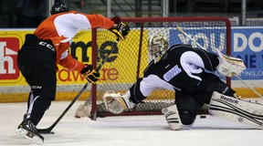 Sarnia Sting goaltender J.P. Anderson stretches across his crease to try to make a save on teammate Alex Renaud during practice Wednesday, Feb. 20, 2013 at the RBC Centre in Sarnia, Ont. (PAUL OWEN, The Observer)