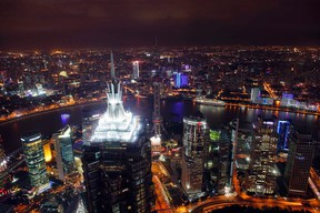 The city of Shanghai, population 23 million, viewed from the 101-storey Shanghai World Financial Centre. By the end of this century, economist Paul Romer argues, giant cities like Shanghai with populations greater than 10 million will be the centres of power and influence.