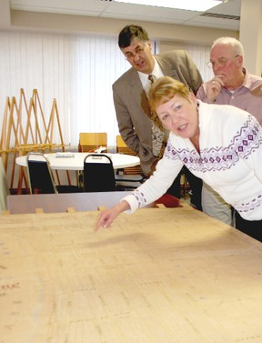 Heritage Kincardine unveiled a historic map of the area during a Feb. 21 meeting of Kincardine. The map, which was hand-drawn by J. H. Scougall in 1880, took four years to restore. Mayor Larry Kraemer and councillors Randy Roppell and Maureen Couture inspected refurbished document.