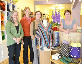 Celebrating their grand opening from left to right are Jeffi Farquharson, Kirsten Dyer, Peggy Call and owner Sue Gundrum.