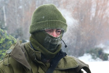 The cold temperatures at Candle Lake Saskatchewan are manifested on this reservists face as a demonstration by the Canadian Rangers is waatched. The reservists were at Candle Lake Saskatchewan recently for Exercise Arctic Bison, an arctic training exercise.GREG WISEMAN/MELFORT JOURNAL/QMI AGENCY