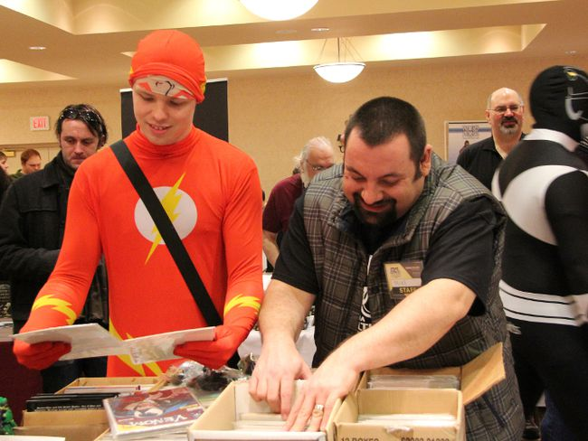 "Wade Alexander (aka ""Flsah"") and Mike Morgado sift through some comic books at the Sarnia Pop Culture Show held at the Holiday Inn, Sunday. The multi-genre convention, which featured comic books, games, and several fan related vendors, drew hundreds of visitors. TARA JEFFREY/THE OBSERVER/QMI AGENCY"