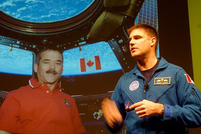 Astronaut Jeremy Hansen from London, Ont. is pictured against screenshot of Canadian astronaut Chris Hadfield during a live 'downlink' chat held at the University of Waterloo, recently. Fellow Sarnia native and university professor Ian McKenzie was instrumental in organizing the event. SUBMITTED PHOTO/FOR THE OBSERVER/QMI AGENCY