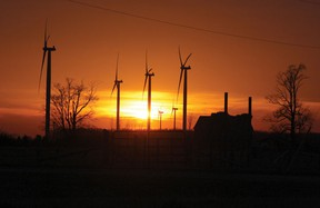 The sun sets behind wind turbines at the Ripley Wind Power project west of Ripley, Ont. in Bruce County. (TROY PATTERSON/KINCARDINE NEWS)
