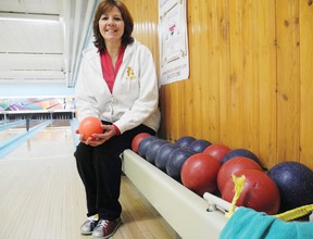 Helene Gilmore, fundraising committee member, ties her bowling shoes to prepare for the sixth annual Rock and Bowl for CHEO and silent auction which takes place this Saturday at Nativity Bowl. Staff photo/ERIKA GLASBERG