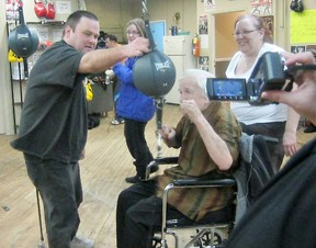 Submitted Photo  Rob Ferguson holds a speed bag for Denis Mallon, who at 92 got to relive his boxing past at the Black Eye Boxing Club.