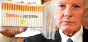 QMI file photo  Gary Grant, national spokesperson for the National Coalition Against Contraband Tobacco, displays a carton of contraband cigarettes.