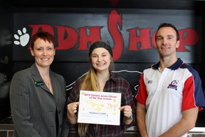 Mackenzie Coombe, 17, accepts a nomination certificate for the Ontario Junior Citizen of the Year Awards from Paris District High School teacher Steve Burroughs and sponsor TD Canada Trust representative Tanya Taylor-Gracey, branch manager in Paris on Monday, Feb. 25, 2013. MICHAEL PEELING/The Paris Star/QMI Agency