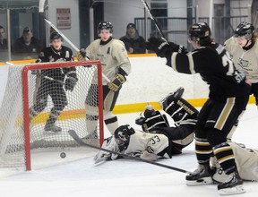 Cobourg Cougars' Mark MacAulay celebrates the eventual game winning goal in the Cougar's 6-4 win over the Trenton Golden Hawks in the opening game of their OJHL Northeast Conference quarter-final series Thursday night at the Community Gardens.