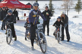 Canadian cyclocross national championship competitor Pepper Harlton took junior bikers for a quick spin at Voyageur Park, during the Devon Bicycle Association's second annual Blizzard Bike Race on Saturday, Feb. 23. Cyclists of all ages, 55 in all, competed in several categories. Harlton would go on to win in the women's 5-lap mountain bike race.