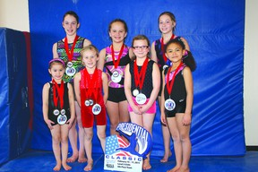 These seven ladies, plus two more, competed recently in a gymnastics event in Orlando, Florida. At back, left to right, are Alyssa Cowan, Jaimie Ramsay, Megan Pashulka. In front, left to right, are Adiel Doroshuk, Cora Croteau, Anya Danku and Brooklyn Lloyd. Missing are Keira Regnier and Cassandra McNutt. The group returned from the competition with 15 medals.