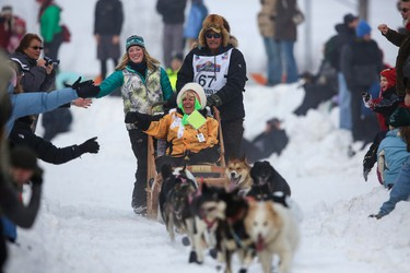 Sonny Lindner's team races down Cordova Street during the ceremonial start to the Iditarod dog sled race in downtown Anchorage, Alaska March 2, 2013.   REUTERS/Nathaniel Wilder  (UNITED STATES - Tags: SPORT ENVIRONMENT ANIMALS)