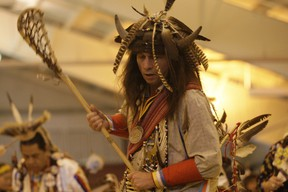 """THE CREATOR'S GAME – Frank Belleau from Garden River First Nation dances at the Eighth Annual Gathering at the Rapids Powwow at Algoma University last weekend. Belleau dances with a lacrosse stick that he feels is important to his cultural roots and was historically called """"the Creator's Game."""" The annual powwow attracts participants from all over central North America."""