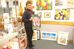 Local artist Sandra Florence poses amidst some of her vibrant offerings in Kincardine's Victoria Park Gallery. Florence's work will be featured as part of the Saugeen Room Showcase at Cava Coffee Cafe through April 8.