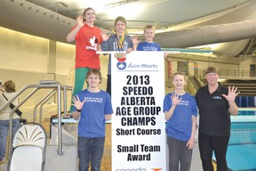 CBAC swimmers, from top left: Kayla Goruk (red shirt) Brock Hoel, Lincoln Hoel, coach Lynne Driessen, Alex Pratt and Parker Knibb celebrate their team's fifth-straight small-team award.