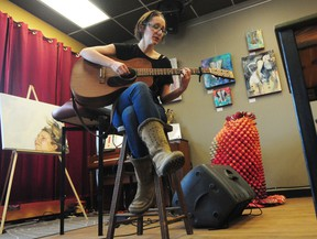 Singer-songwriter Dana Wylie performs a song at the media launch for SkirtsAFire, herArts Festival, at the Carrot Coffehouse, 9351 118 Ave., on Thursday. The inaugural festival showcases the works of female artists across multiple disciplines including music, theatre and poetry. Trevor Robb/Edmonton Examiner