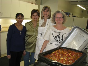Members of the International Women's Day committee made chili for 300 on Wednesday at Woodstock and Area Community Health Centre. From left Nischa Gupta, Mary Anne daCosta, Heather Werby and Phyl McCrum. HEATHER RIVERS/WOODSTOCK SENTINEL-REVIEW