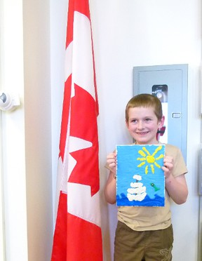 Ezra Peters and his stamp design - a sailboat on the sea